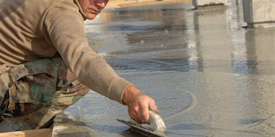 an image of a man screeding concrete