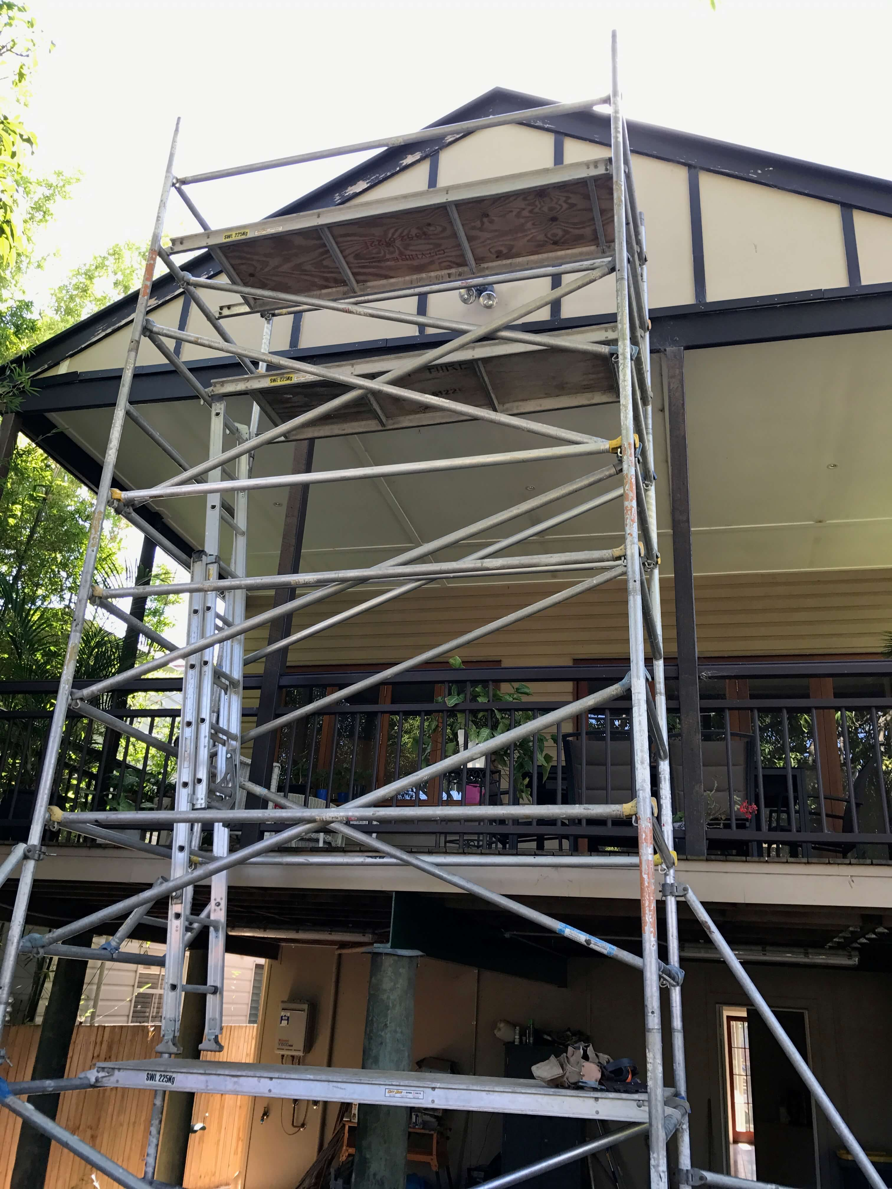 mewald building scaffolding on back of home in renovations