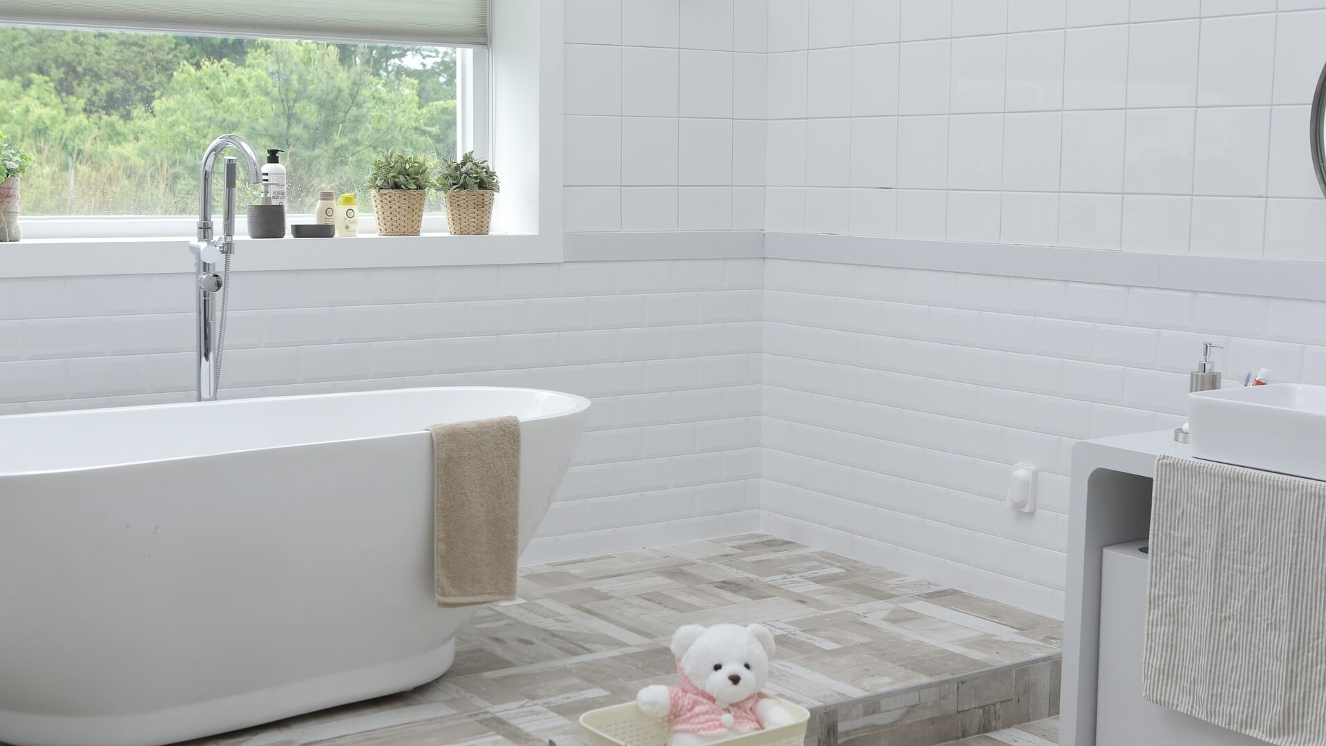 mewald building white bathroom with bathtub, tiles and sink