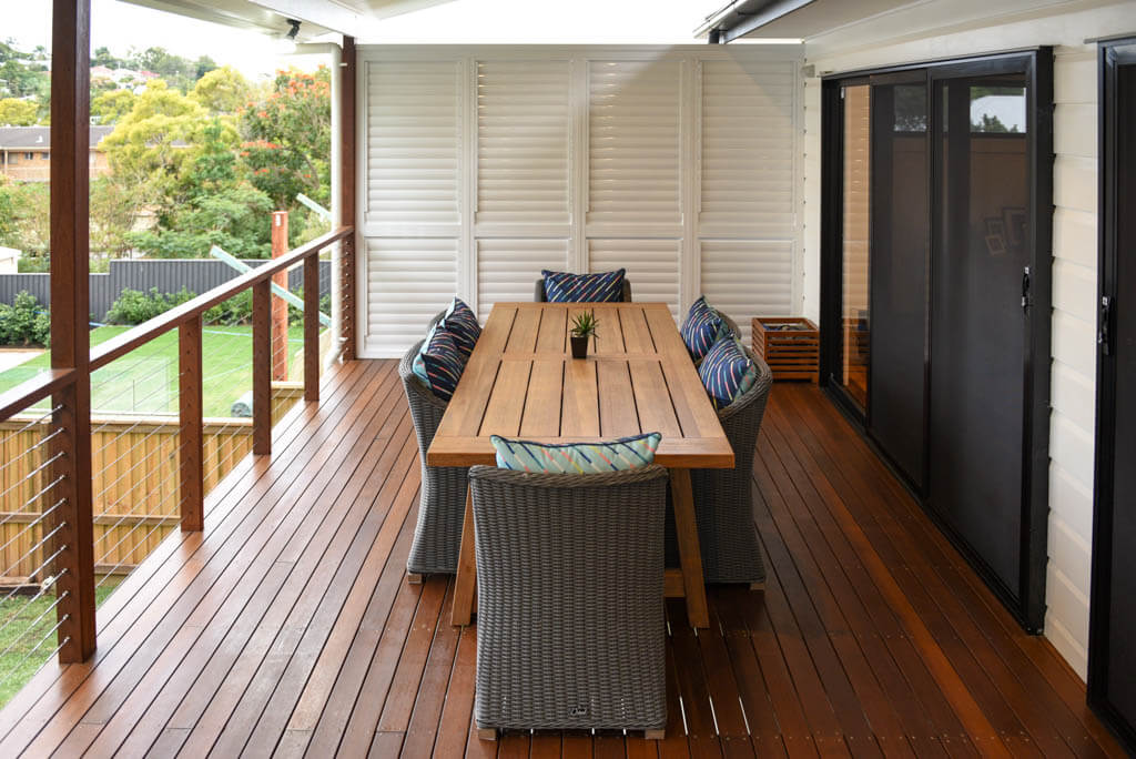 mewald building timber deck with shutters, outdoor dining area